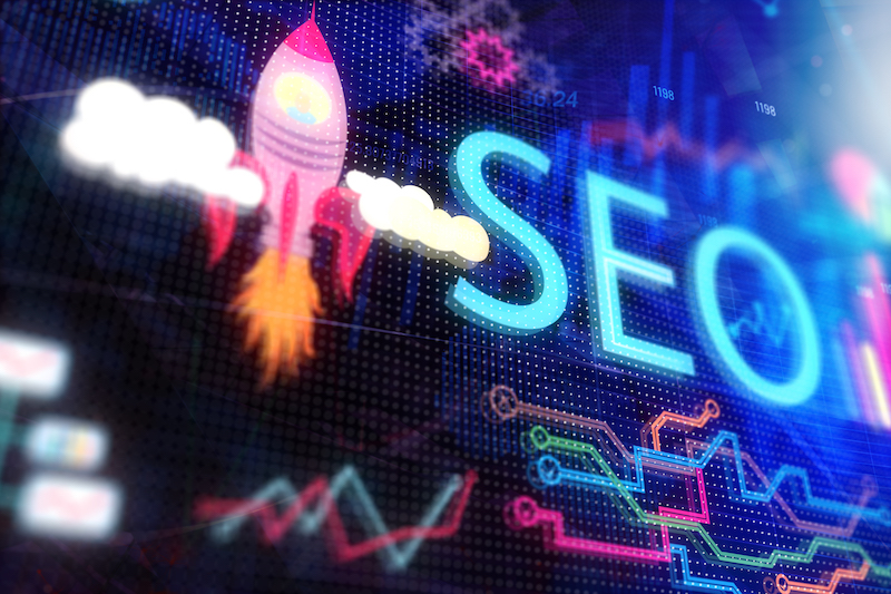 Colorful diagram of rocket and the letters SEO